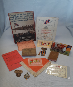 Items from the First World War Loan Box, including replica documents and medals
