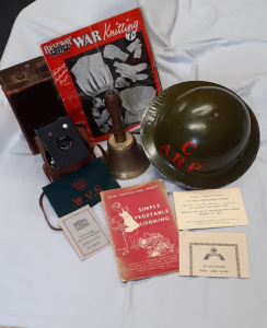 items from the Second World War Box, including a dark green ARP helmet and a recipe booklet